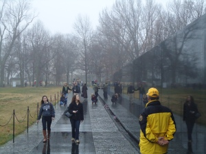 Abby Bedore, left, and Caitlin Robertson, right, view the Vietnam Memorial.