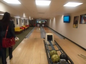 The pair of lanes fills the room with a seating area to the left.