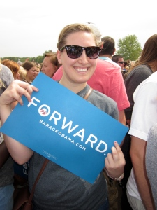 Holding an Obama campaign sign- 2012