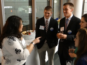 Martha Fung (left), 2004 Drake University alum, talks with juniors, Zachary Keller (center) and Lucas Mueller (right), about her experiences.
