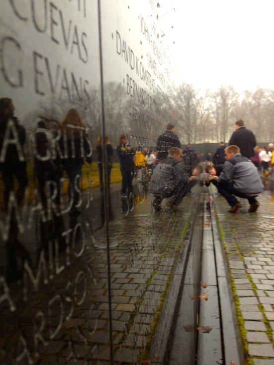 Lucas Mueller takes some time to reflect at the Vietnam Memorial