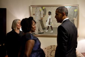President Barack Obama speaking with Ruby Bridges in front of the Norman Rockwell painting of Bridges