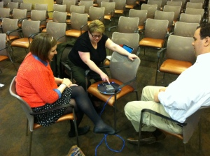 Katherine Fritcke, Prof. Caufield, and Drew Kaufman phone into Iowa Public Radio [Photo by Jill Van Wyke]