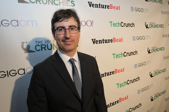 John Oliver is the host of  Last Week Tonight, integrating some actual investigative journalism into his comedic reporting. Photo by TechCrunch at https://creativecommons.org/licenses/by/2.0/legalcode
