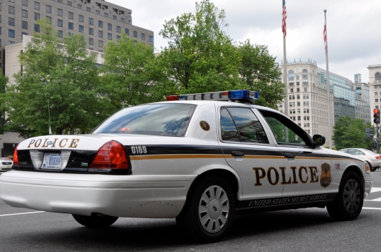 The Secret Service's cruisers patrol the streets around the White House. The agency is trying to recover from its embarrassing breeches near the end of 2014. Photo by Roger Schultz at https://creativecommons.org/licenses/by/2.0/legalcode