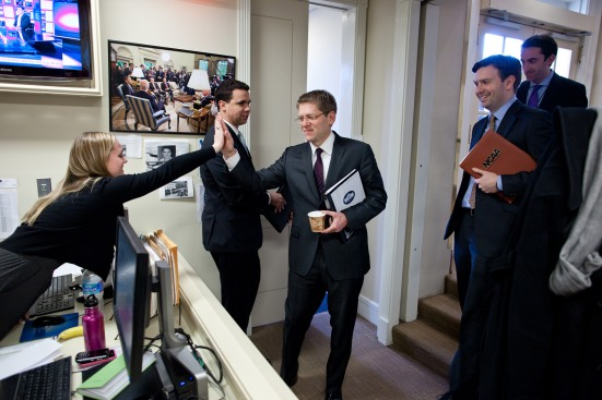 Former Obama Press Secretary Jay Carney high-fives a coworker as current Press Secretary Josh Earnest (left) looks on. The Obama White House has restricted press access at unprecedented levels.  White House photo.