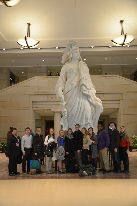 At the Statue of Freedom in the Capitol visitors' center. Photo by Jill VanWyke