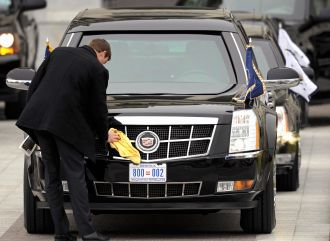 President Obama's limo being polished while sporting a new license plate  during the inauguration in January of 2013. Photo courtesy of the Washington Times