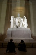 Josh and Sarah sit in front of Lincoln. Photo by Grace Dunn
