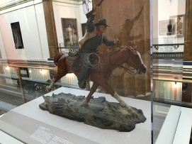 Iconic film star John Wayne riding one horse of many he has ridden throughout his roles. (Photo Credit: Riley Fink)